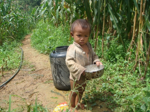 child carrying water